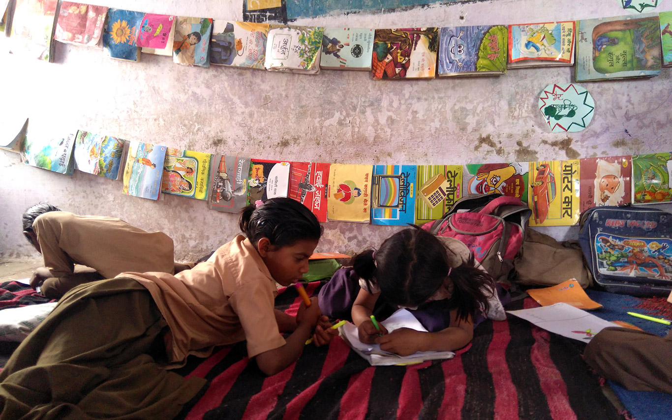 Students engrossed in a post read aloud activity in a library in Abu Road